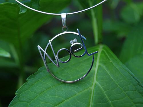 Witgouden hanger met naam en diamant